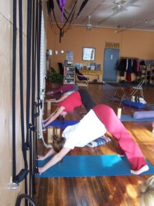 Down Dog in Yoga is good for lengthening hamstrings and opening shoulders when done correctly