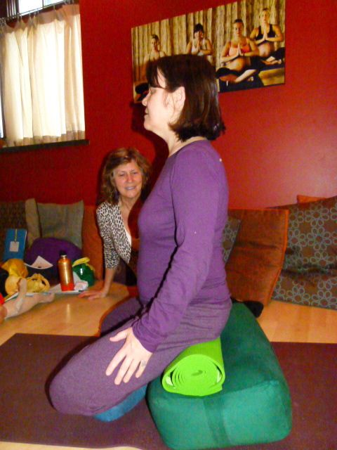 Liz Koch giving Gail a lesson in sitting on a bolster