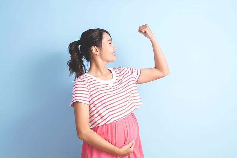pregnant woman flexing